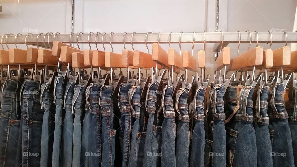 unisex clothing. jeans waiting for their owners