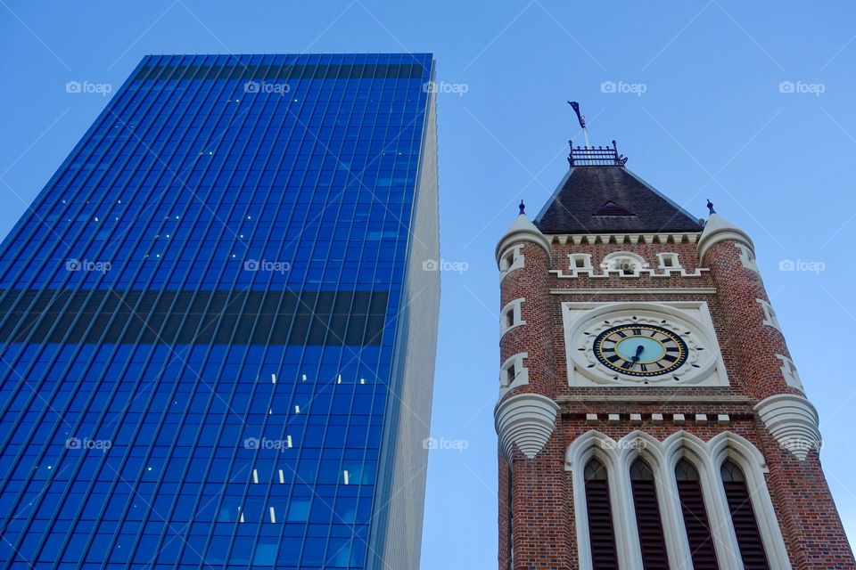 Old architecture, called Perth Town Hall, and contemporary building in Perth, Western Australia.