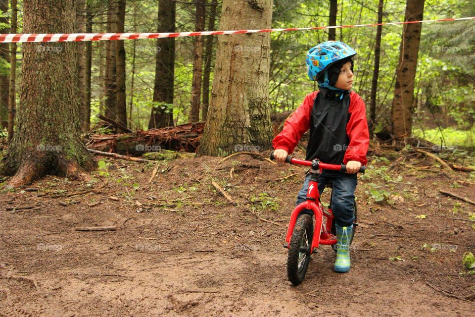 Child riding bike in the nature