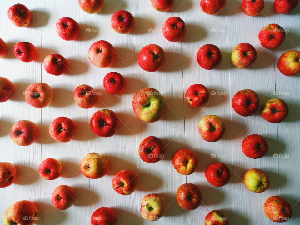 a lot of red apples on a white background
