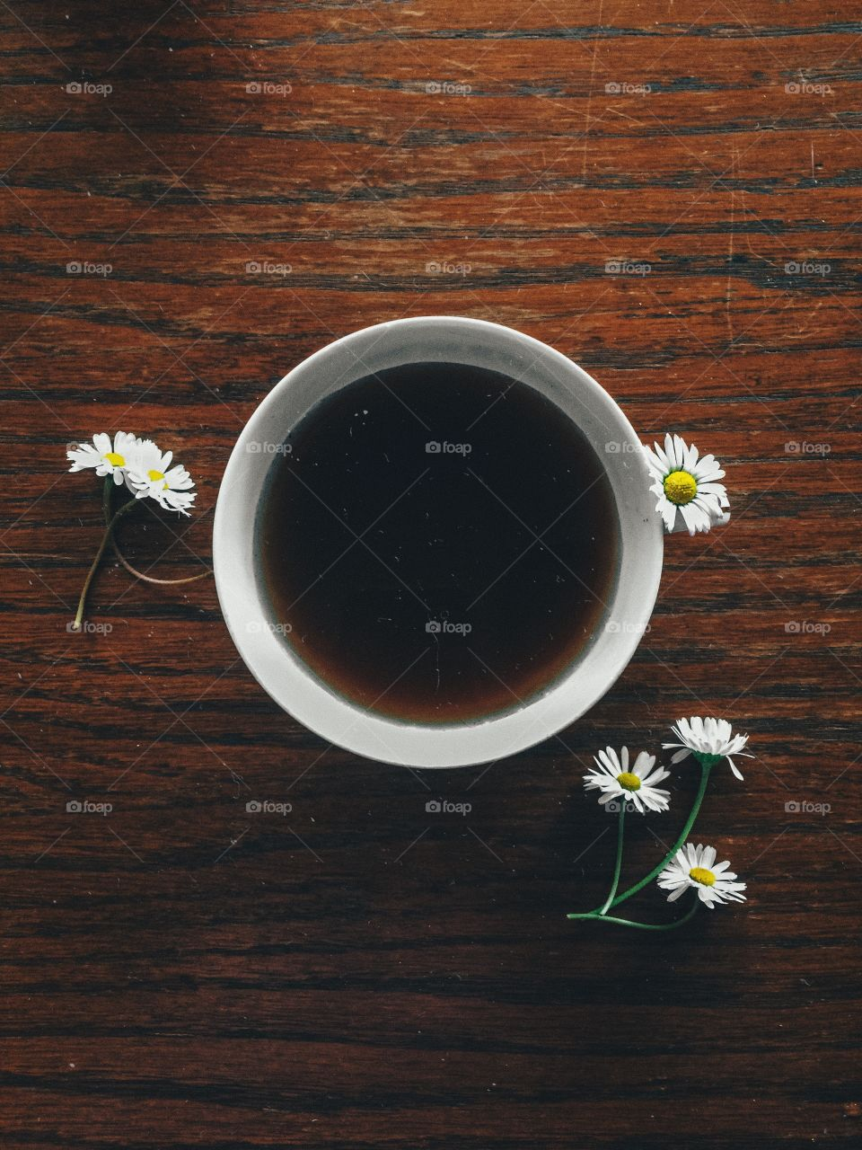 Coffee and daisies