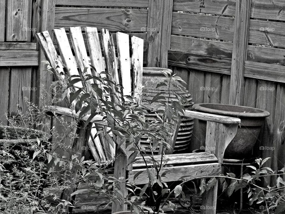 Old Chair. Photo of a wooden chair in the vicinity of a shower house waiting for someone to occupy it!