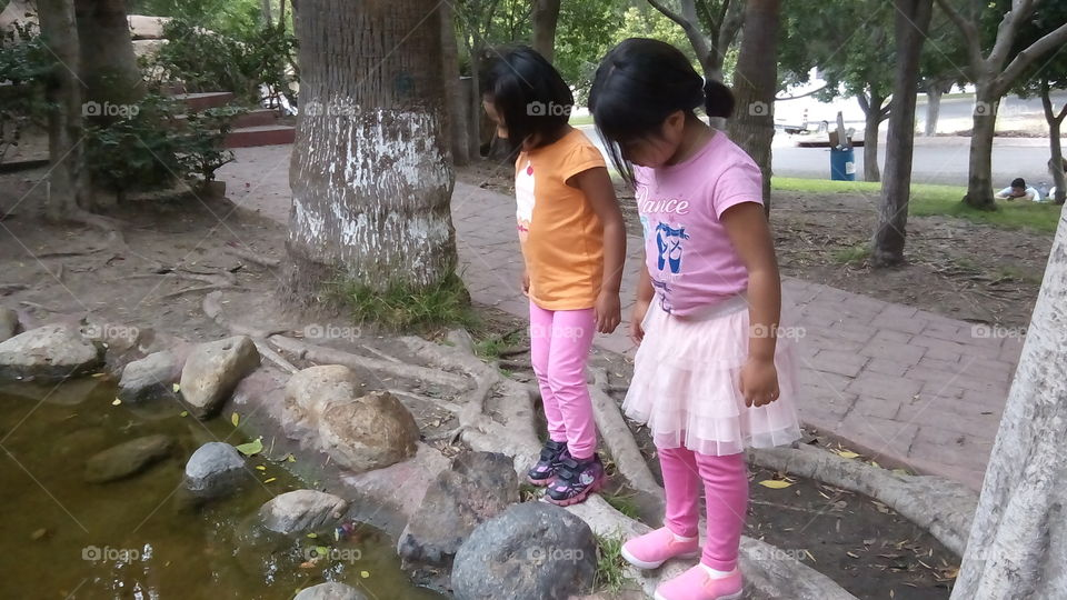 Finding Fishes.. Two girls finding fishes.