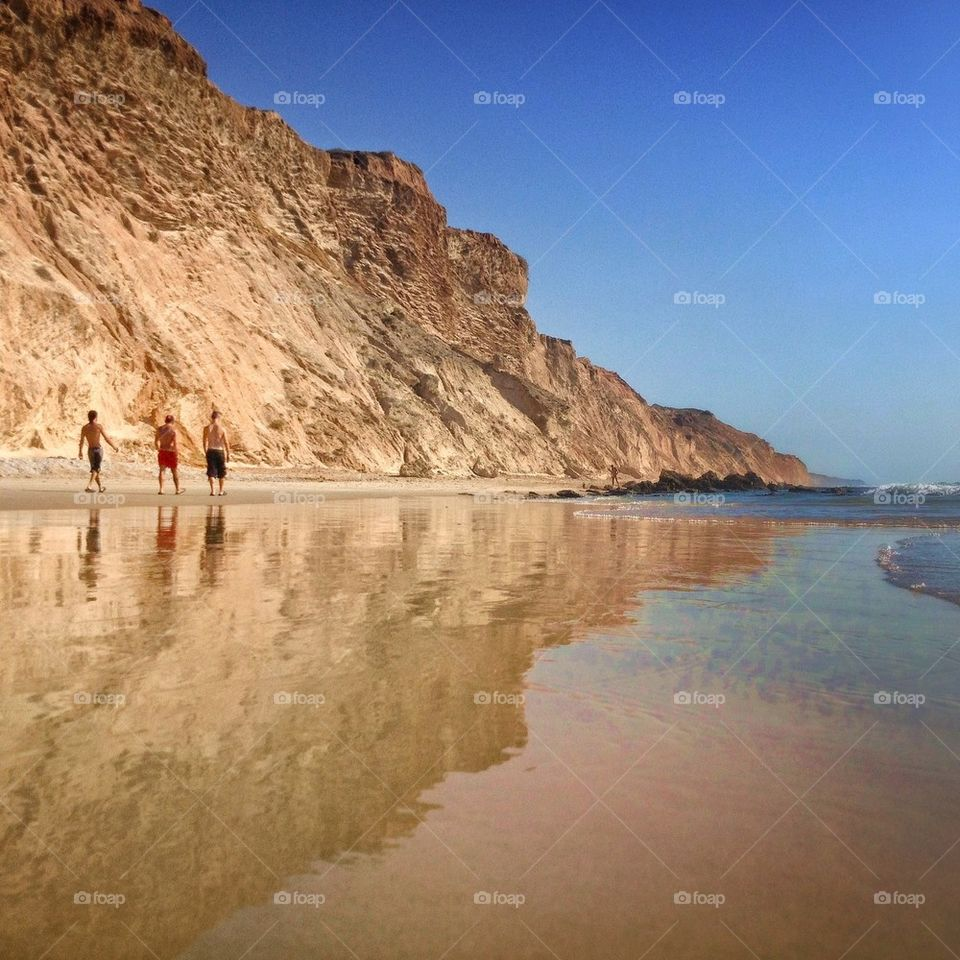 Rear view of people on beach