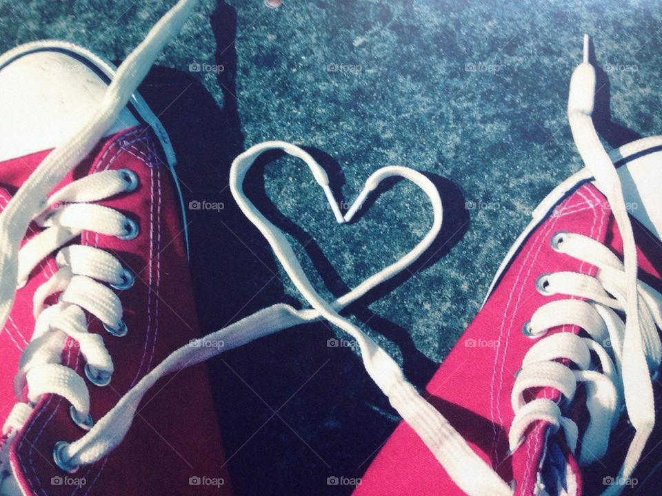 Young love concept heart shape laces pair red