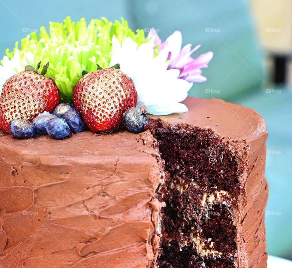Flowers and fruits on cake