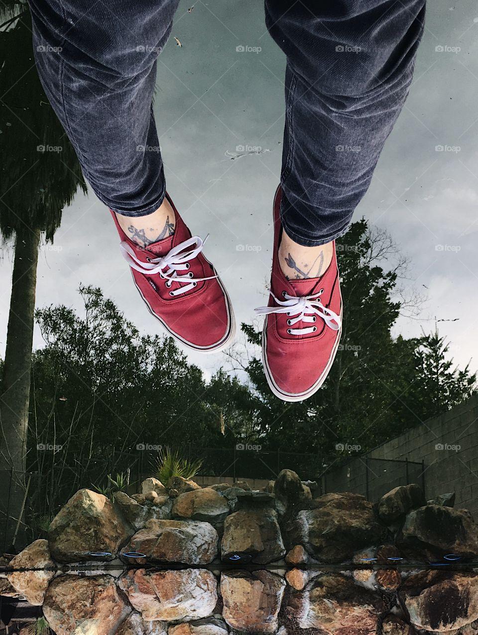 Feet over water.