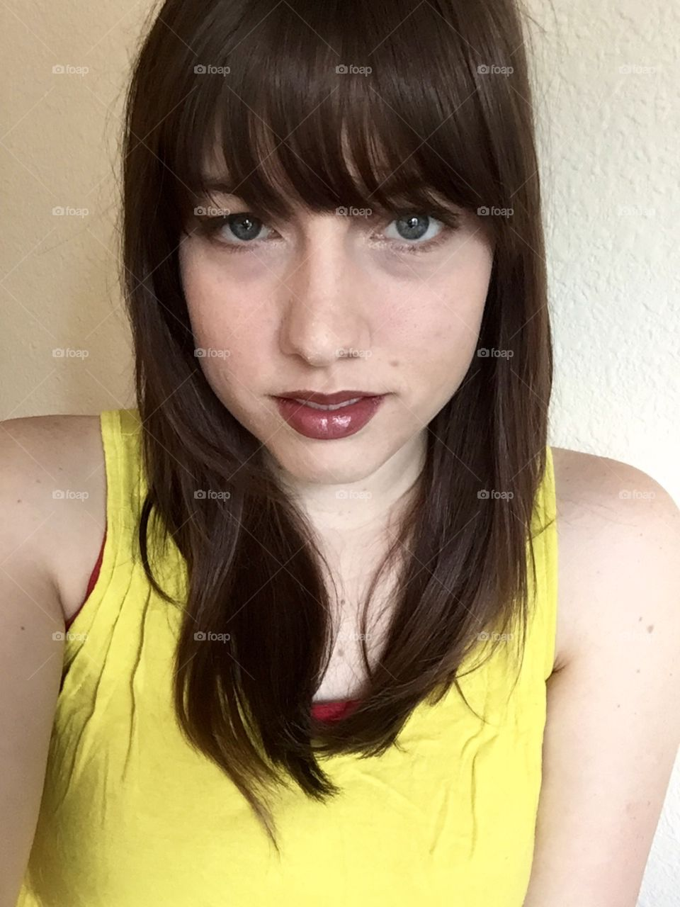 Cut my own bangs and felt good about it. Taken during my summer marketing internship in Colorado. I was 20 with blue eyes and a fair complexion.