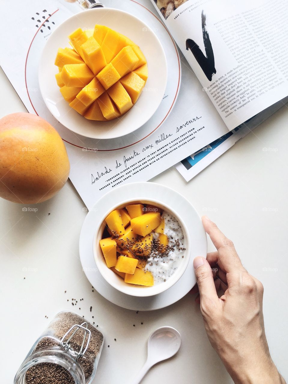 Healthy breakfast bowl with R2E2 mango, yogurt, chia seeds and perilla seed.