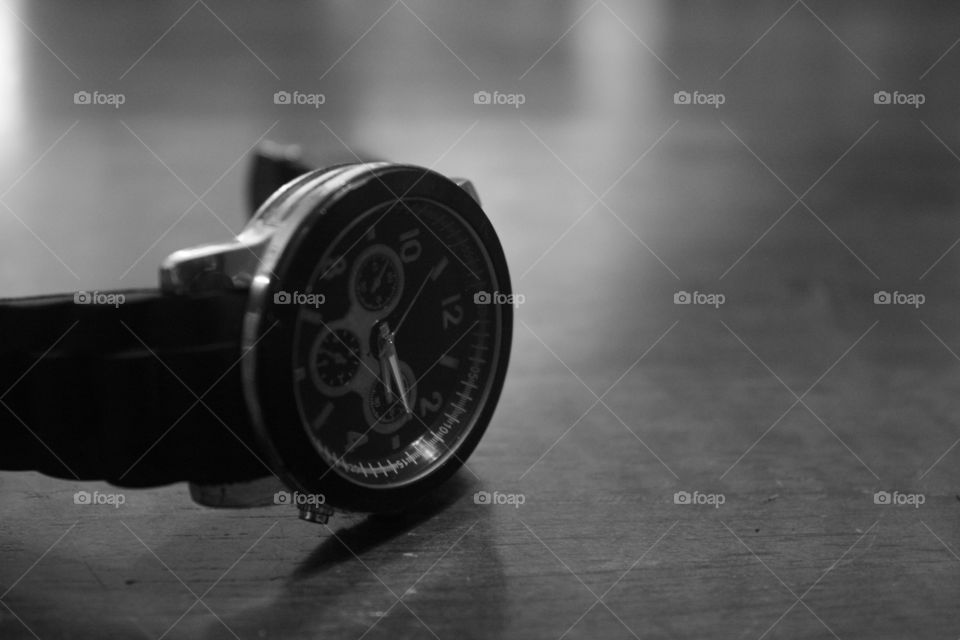 Close up monochrome watch that shows that we are ignorance with how precious time is for us.