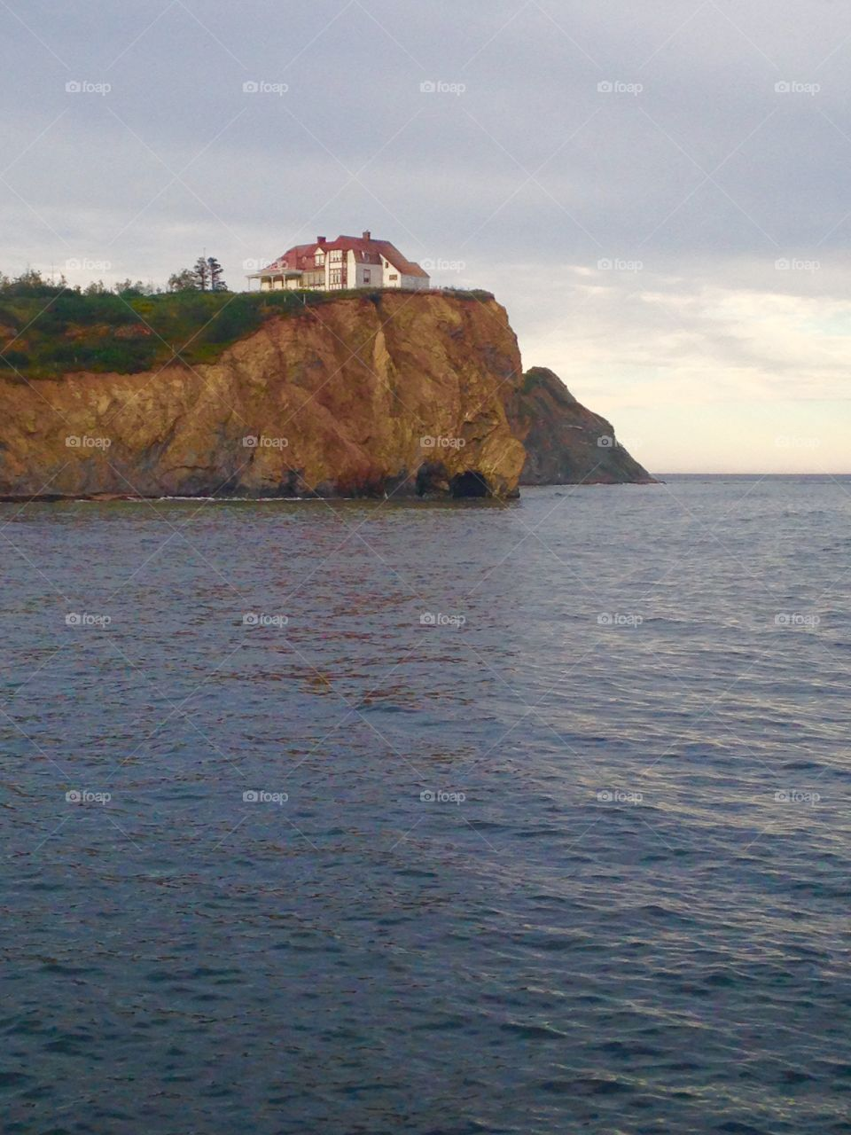 Historic red home on the shore in Perce.