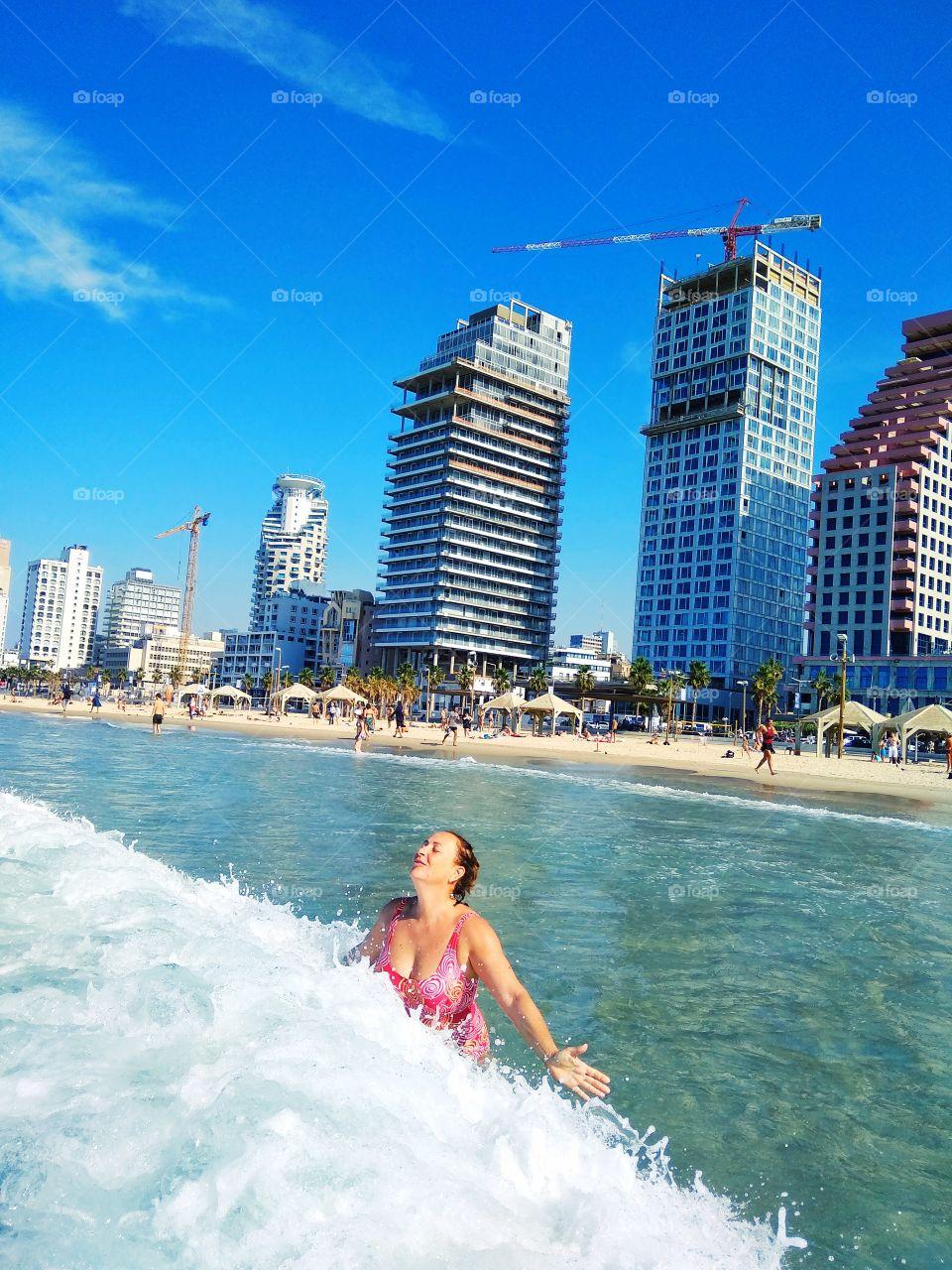 Pure hapiness and fun on beach of Tel Aviv, Israel!