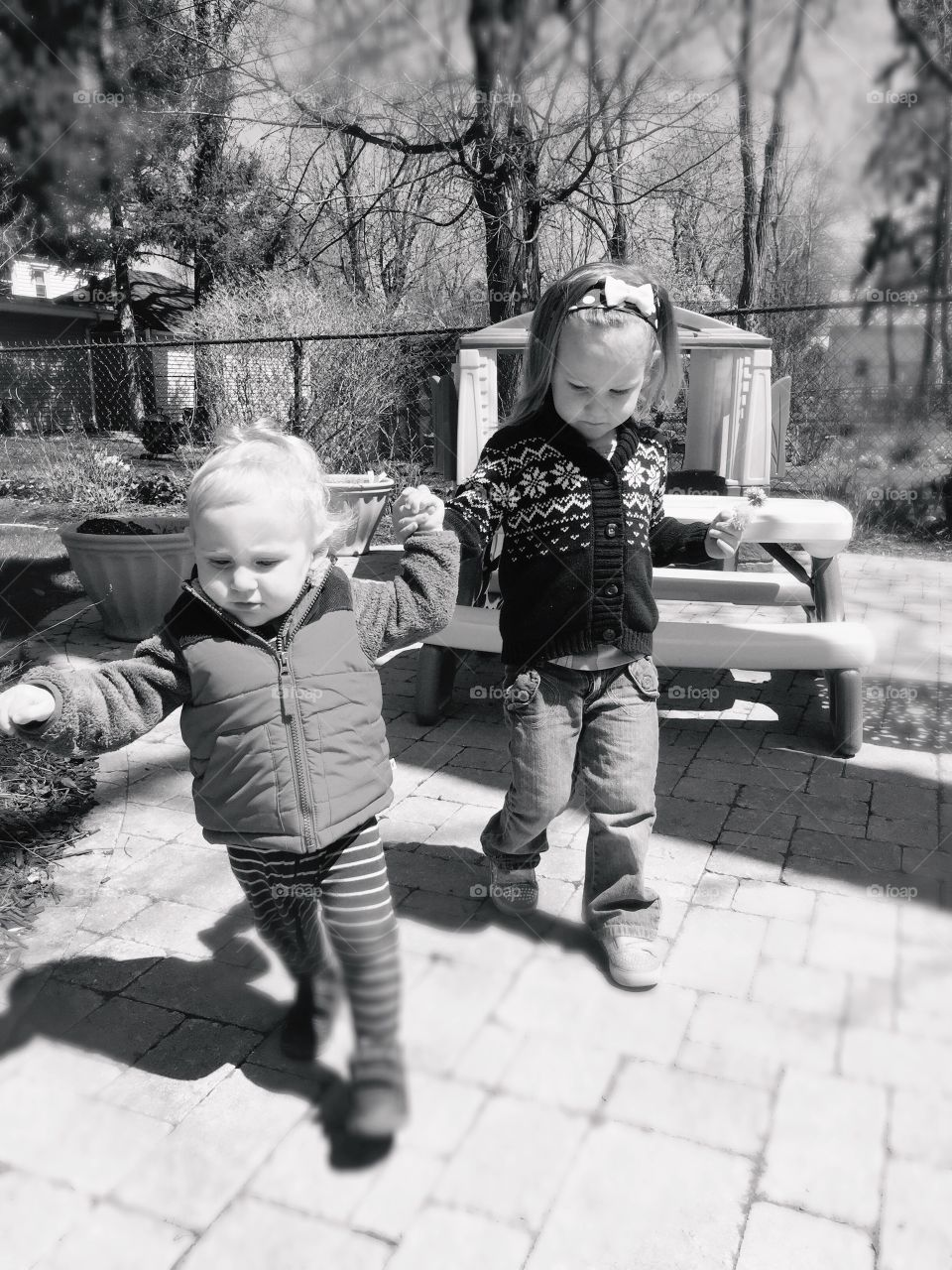 Brother and sister walking on street