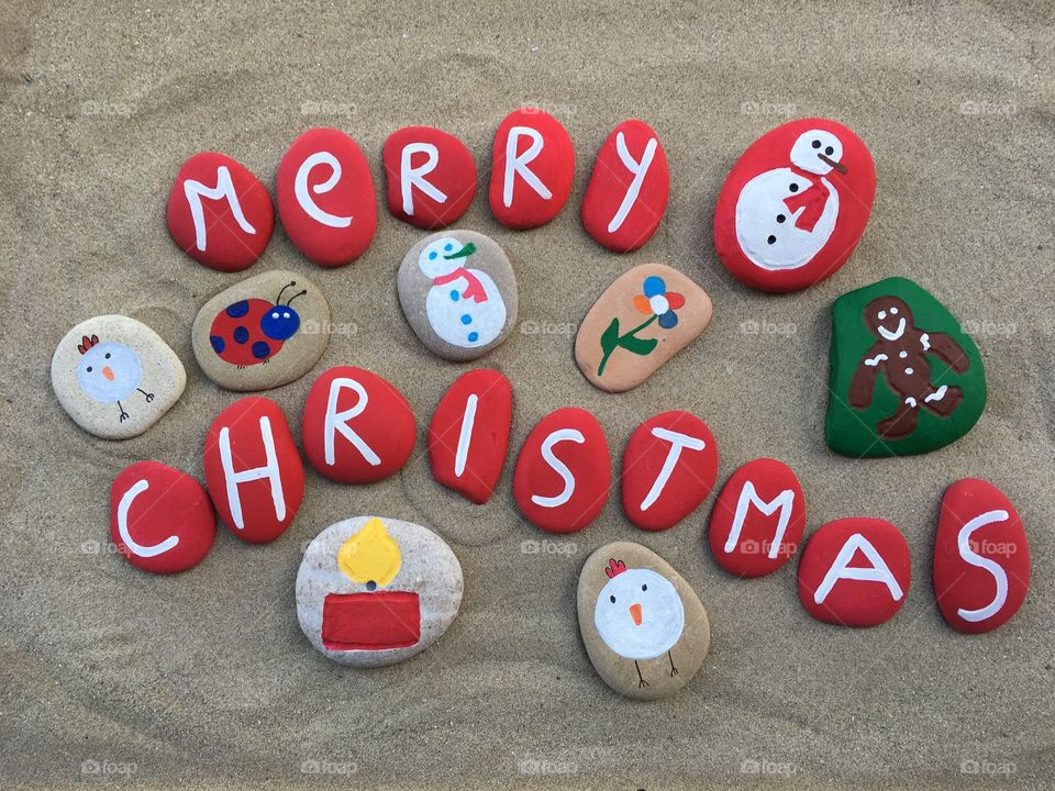 Merry Christmas on multicolored stones