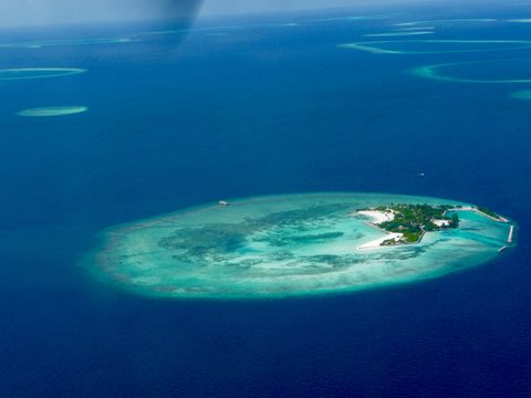 Aerial view of blue sea around Maldives islands