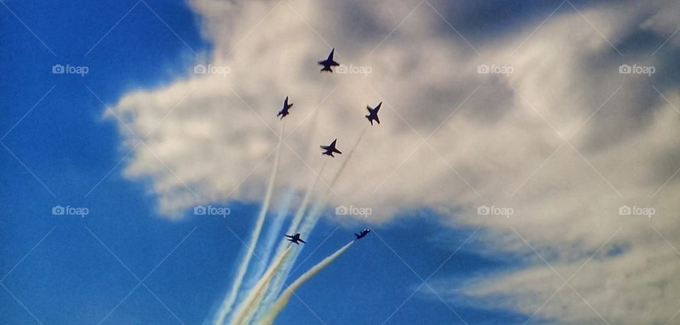 Fighter plane performing airshow in sky