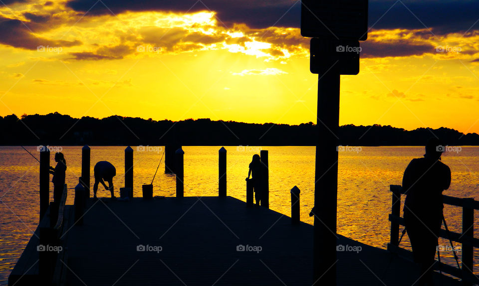 Amazing Silhouettes! Like the meeting of two worlds - the known and the unknown. The sun is like a great big romantic, inspirational fire in the sky. Brilliant streaks of yellow, orange, gold, blue, pink and red overcome the blue and purple of the sky. The sky resembled a prism; all the colors blended perfectly together. It's as if the colors and intensity of the light is just right! My work is done for today. I'm not sure what tomorrow will bring, but I'll be prepared for it!