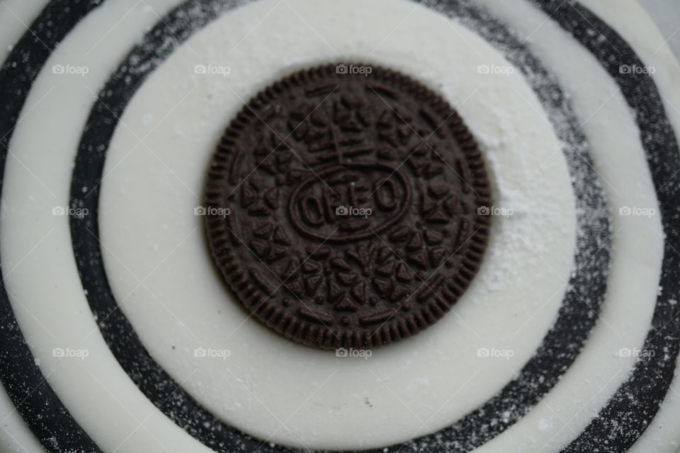 Oreo Biscuit surrounded by black and white fondant icing .. cake topper