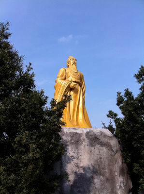 A gold statue at the top of the mountain.