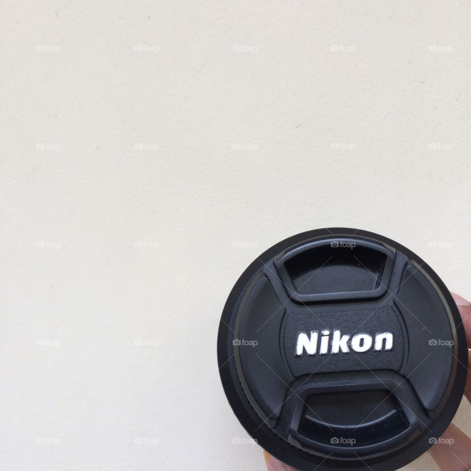 The Nikon's lense cover in minimalist background