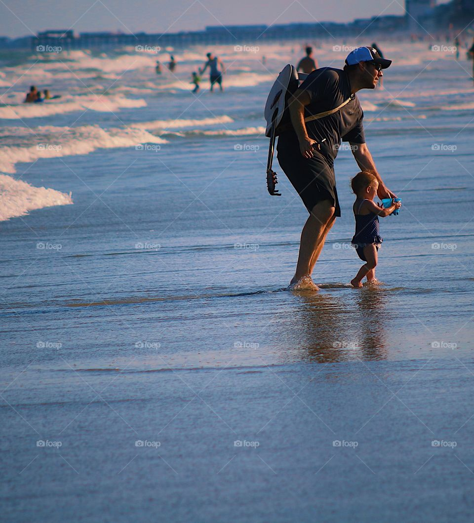 Parenthood father son beach vacation enjoying enjoyment leisure travel