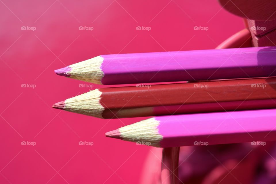 pink color wooden pencils pink background