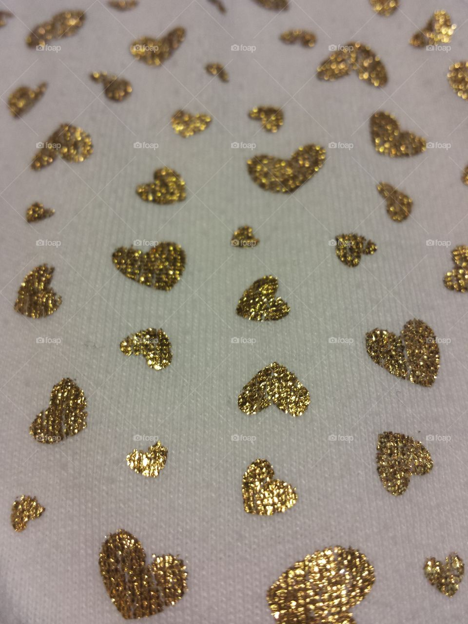 Gold Hearts on White Fabric