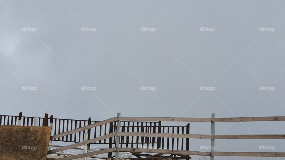 fence in foggy weather