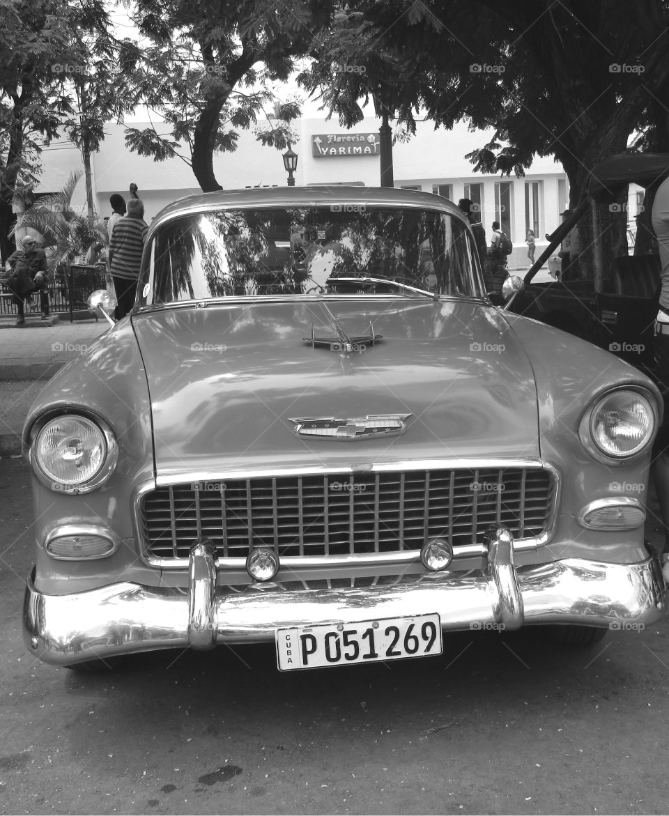 Cuba: Classic Chevy! As I see Santiago de Cuba in black and white, and sometimes in color! Cuba is a special destination and people know how to enjoy themselves, despite obvious signs of poverty and hardships. The streets are filled with vibrant colors and rhythm and it is not uncommon to see people dancing in the streets and alleys to the sound of loud salsa music! Wish I could, but It's impossible to capture it all!