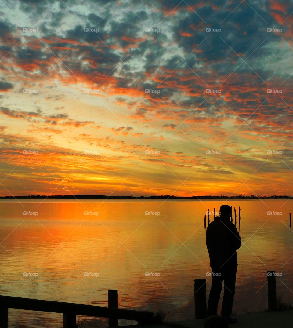 Silhouette of a man at seaside during sunset