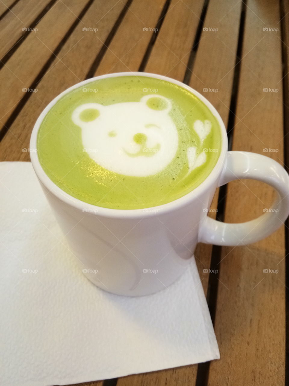 A sip of green tea with bear