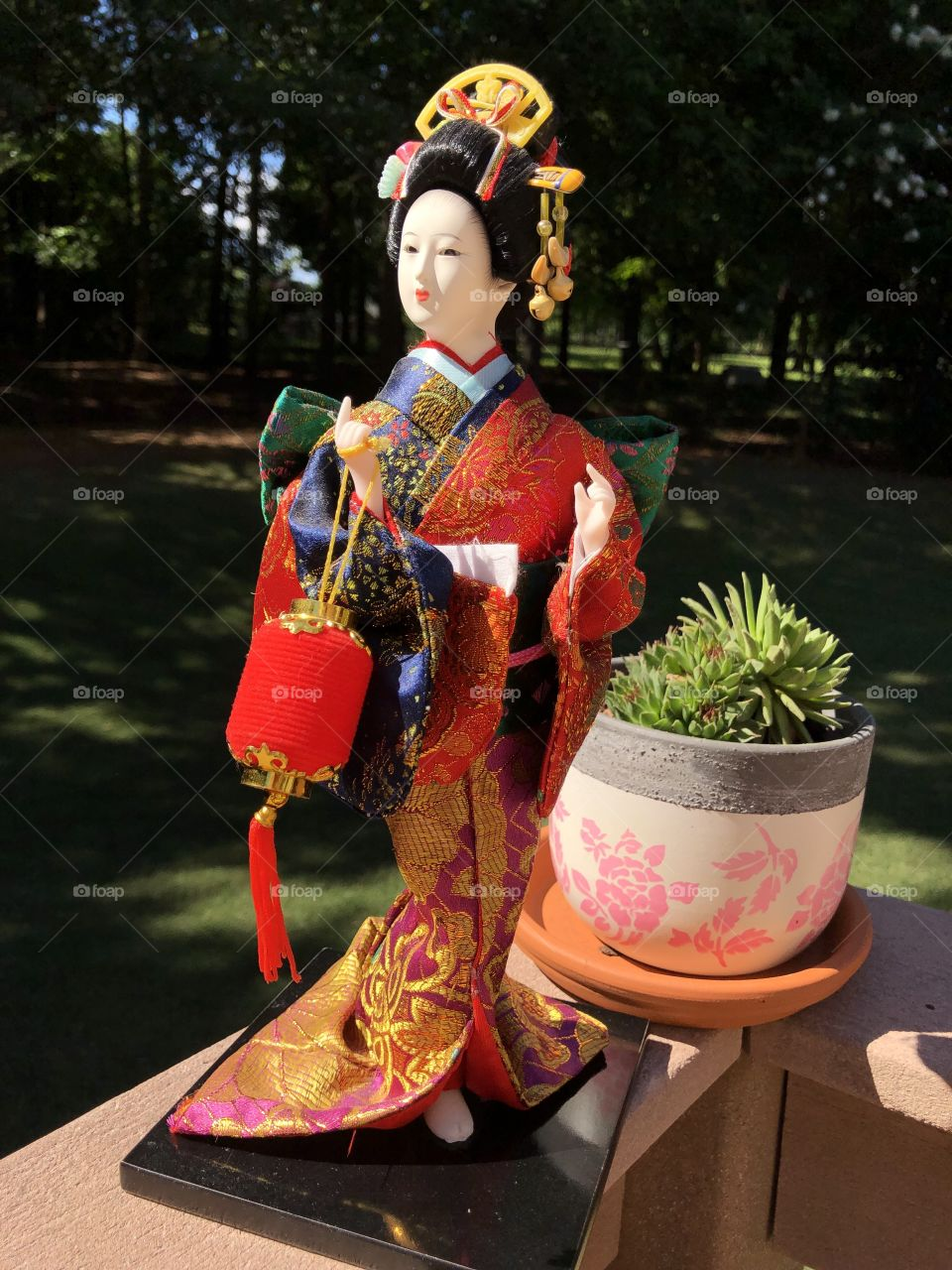 """A precious Christmas gift from my mother due to my love of the movie """"Memoirs of a Geisha"""".  A beautiful Geisha doll in a fashionable colorful silk kimono.  No editing just good photography."""