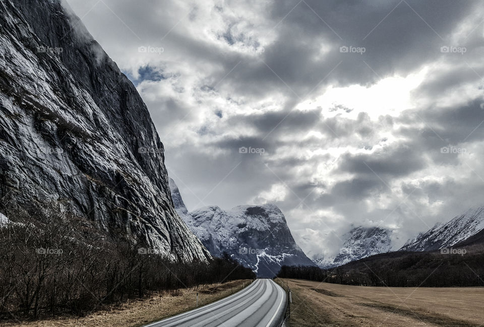 Empty road along with mountains