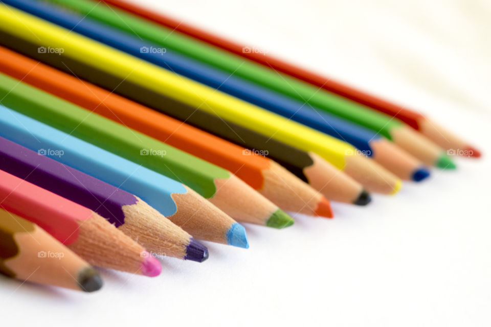 View of colored pencils on white background