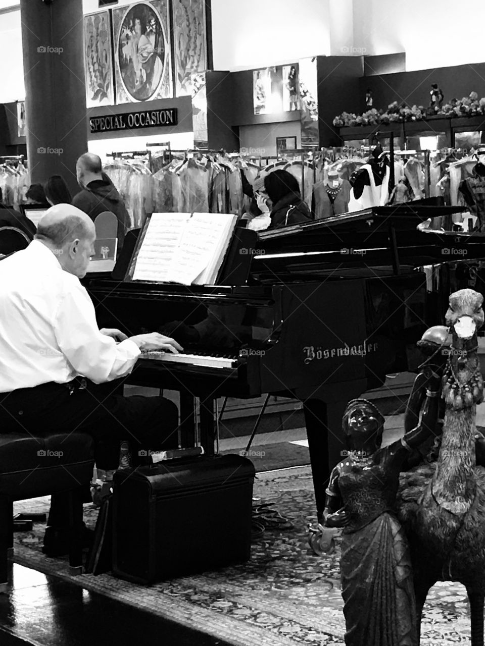Piano Player in Dress Shop