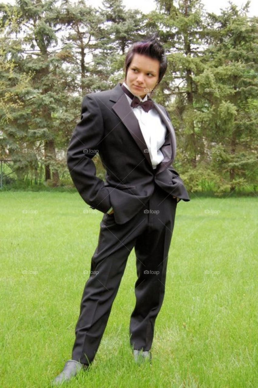 James James Bond. Female dressed in tux for high school prom.