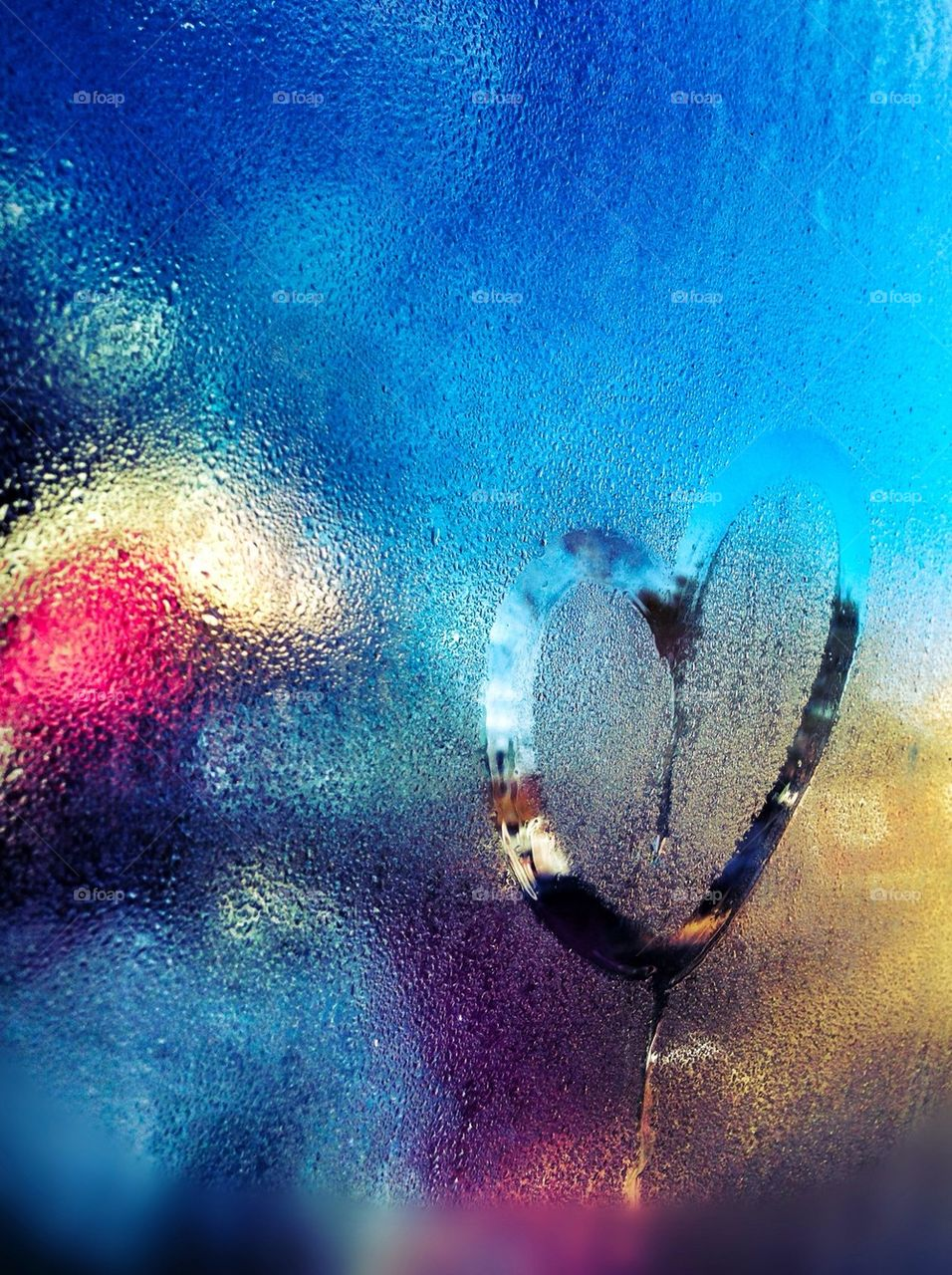 Sign of love heart on glass