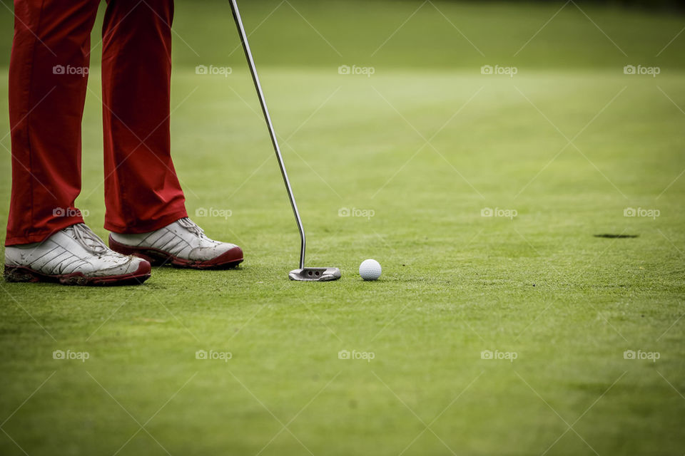 Golf player at hole