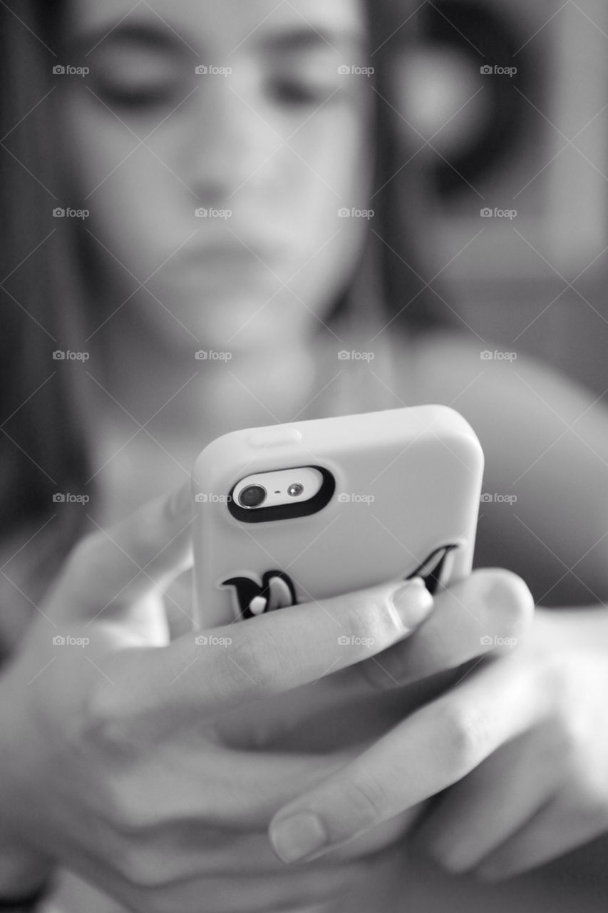 Girl having a chat through her iphone