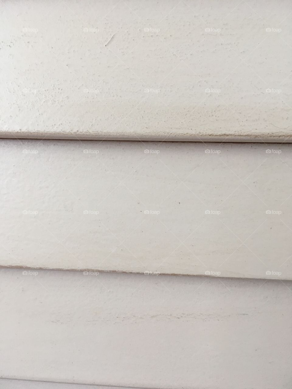 Wooden slats in antique white close up