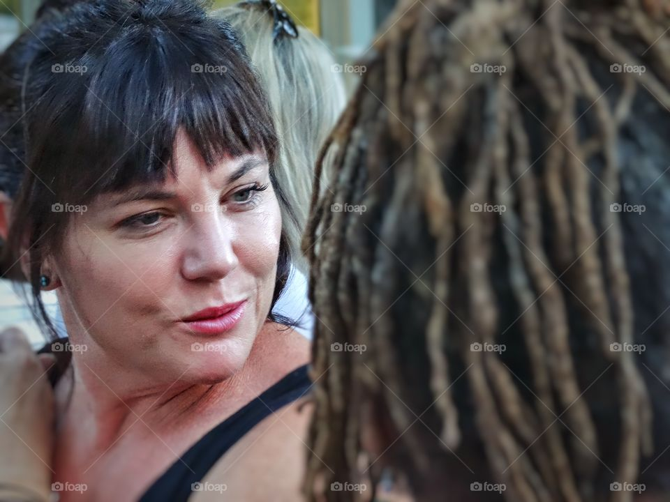 Close-up of mature woman in fringe hairstyle