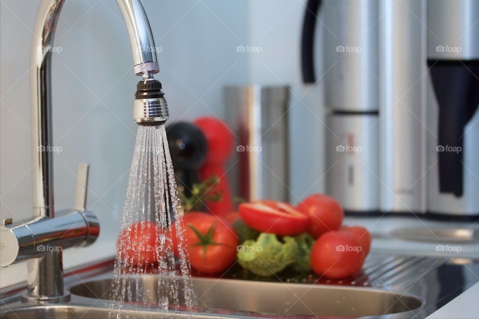 rinsing tomatoes and other vegetables