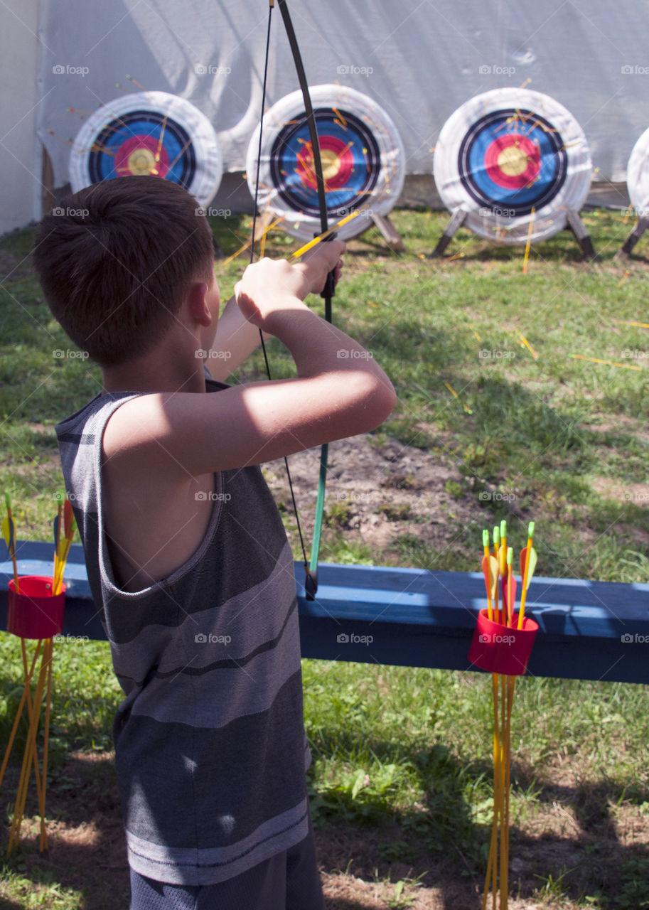 Archery, Boy shooting arrow at a target