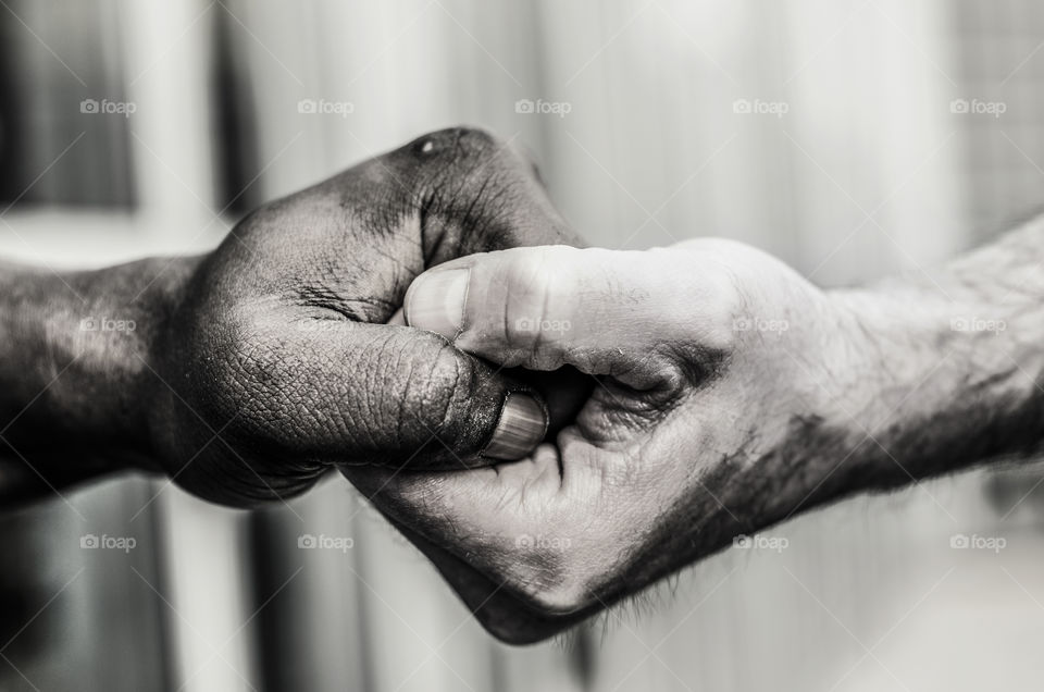 Close-up of two man holding hands