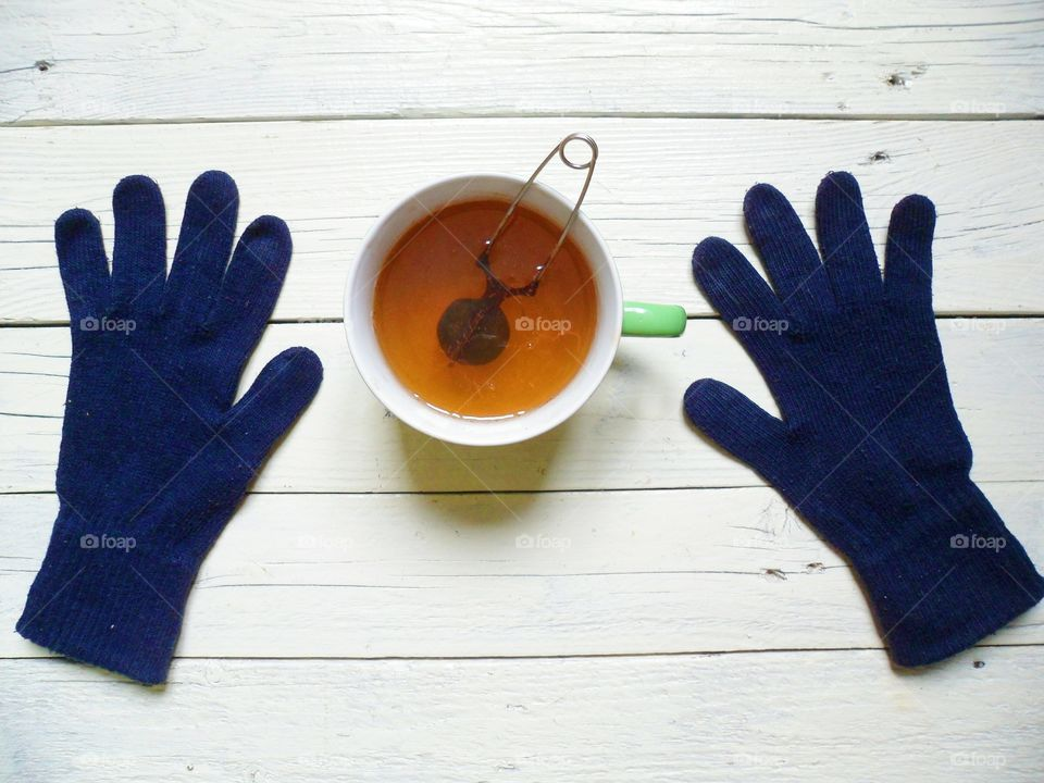 High angle view of tea and blue gloves