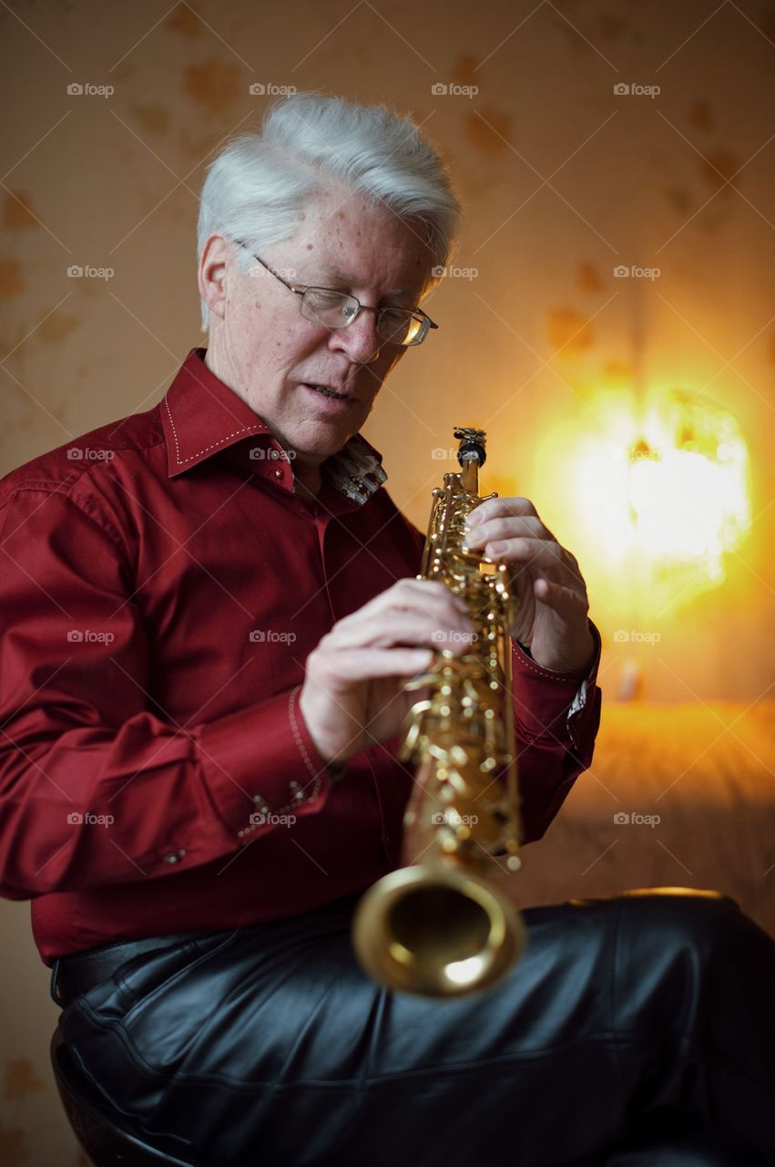 Close-up of a man holding saxophone