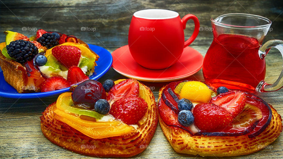 Heart shape pancakes with fruits on wooden table