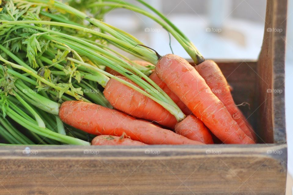 Carrots in wooden box