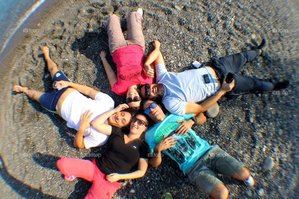 #friends #having fun #circle #on the beach #sandy place #couples