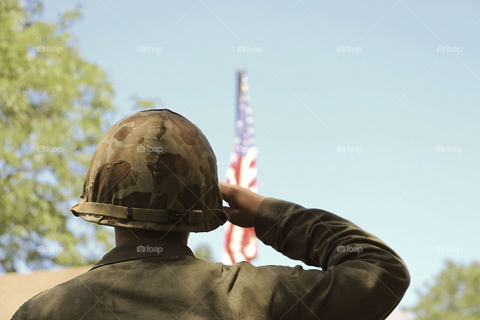 Image reminiscent of World War II soldier saluting the American flag